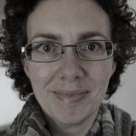 Headshot photograph of experienced researcher Dr Hannah Gill Director and Research Lead at FROM HUMBLE ORGINS.