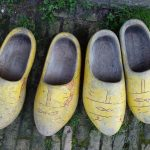 Research European ancestors and birth relatives with FROM HUMBLE ORIGINS. Photograph of yellow wooden clogs accompanying the FROM HUMBLE ORIGINS Specialised Offerings webpage about researching the People that mean the most to you. Image copyright www.freeimages.com / Denis Bilotta.