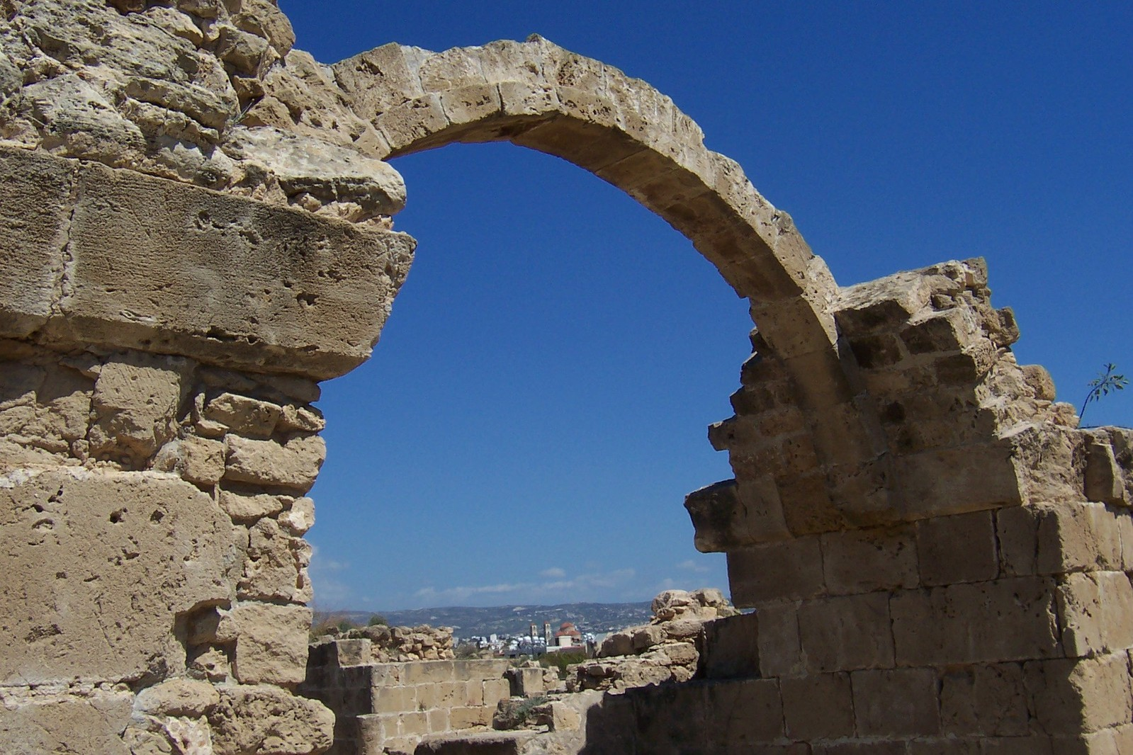 """Photograph of a stone archway set against a blue sky, accompanying the FROM HUMBLE ORIGINS FHOLOGUE blog post """"REALISE YOUR UNIQUE PERSONAL HERITAGE"""". Image copyright www.freeimages.com / hiltonius."""