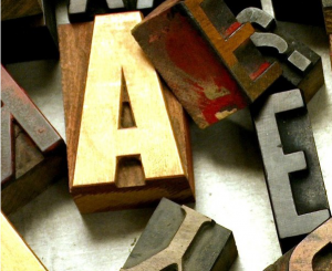 """Image of wooden printing letters accompanying the FHOLOGUE editorial """"The Europe Within"""", discussing European ancestry. Image copyright www.freeimages.com / Daino_16."""