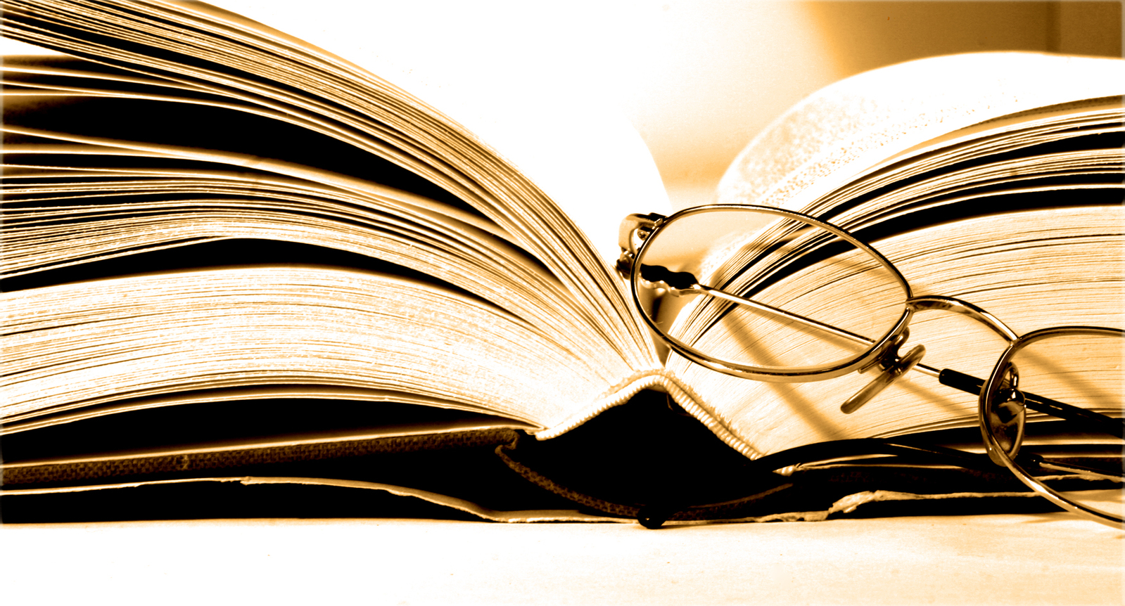 """Photograph of an open book with spectacles. Accompanying FROM HUMBLE ORIGINS' FHOLOGUE blog post """"ACCESSING YOUR PERSONALISED INTELLIGENCE"""". Image copyright www.freeimages.com / Justine Furmanczyk."""